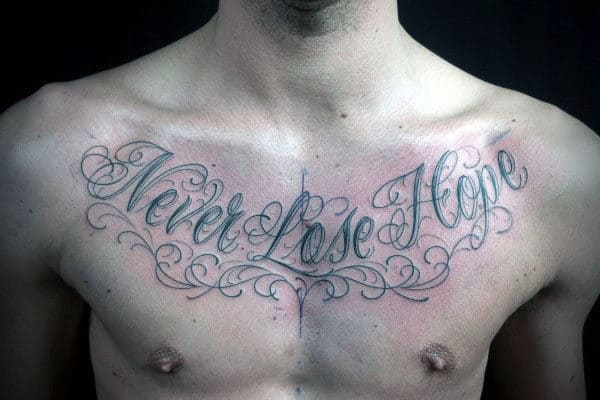 Never Lose Hope Cursive Guys Upper Chest Tattoo