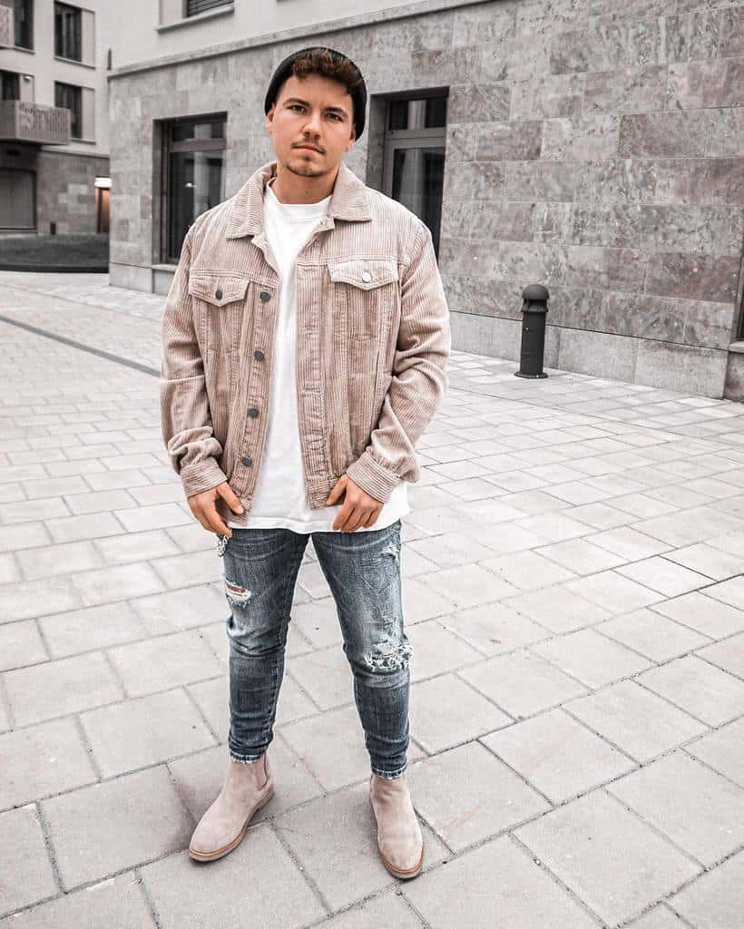 Man wearing distressed denim jeans