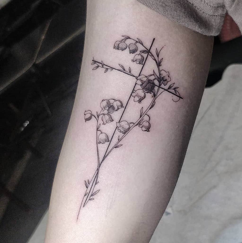 cross-dainty-lily-of-the-valley-tattoo-amandaboik