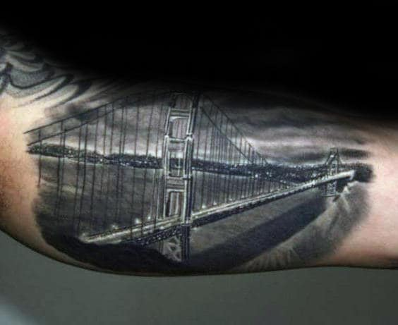 Night Sky With Lit Bridge Mens Inner Arm Tattoos