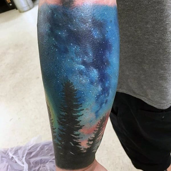 Night Sky With Stars And Pine Tree Forest Inner Forearm Male Tattoos