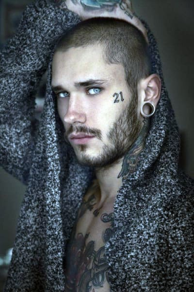 Number 21 Face Tattooo On Gentleman