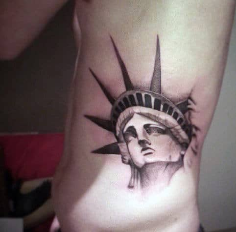 Nyc Statue Of Liberty Tattoo For Men On Rib Cage Side