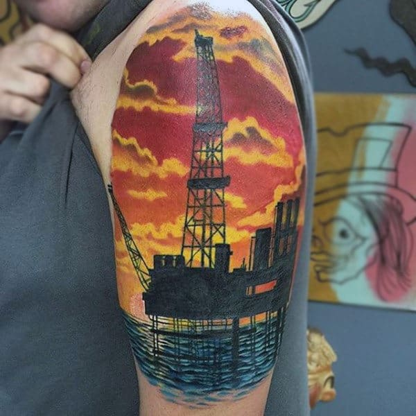 Oil Rig At Sunset Upper Arm Sleeve Tattoo On Man