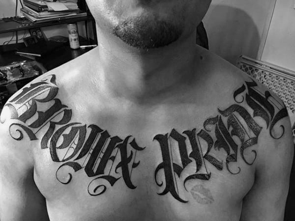 Old English Male Upper Chest Black Ink Tattoo Word Designs