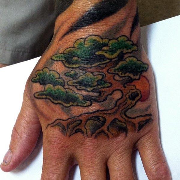 Old School Bonsai Tree Male Tattoo On Hand With Rising Run