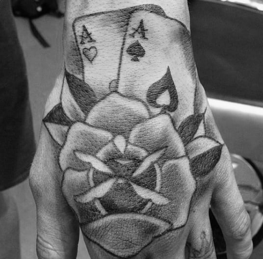 Old School Flower With Aces Playing Card Mens Hand Tattoo