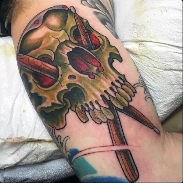 Old School Green Skull Drum Sticks Mens Bicep Tattoos