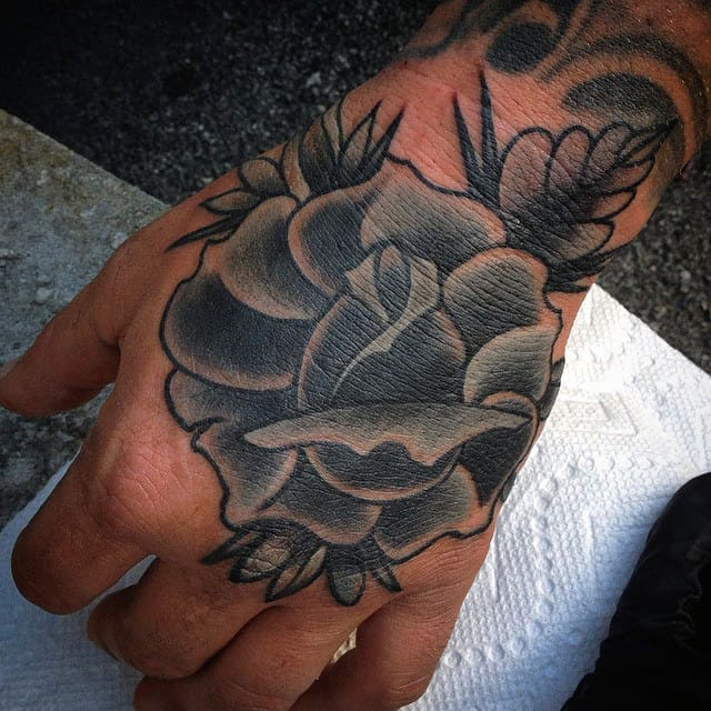 nextluxury hand 2 black and grey rose tattoos