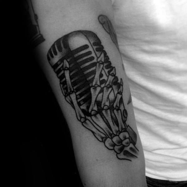 Old School Guys Skeleton Hand With Microhpone Tattoo Design Ideas On Arm