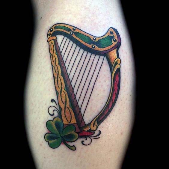 Old School Harp With Clover Irish Guys Arm Tattoo