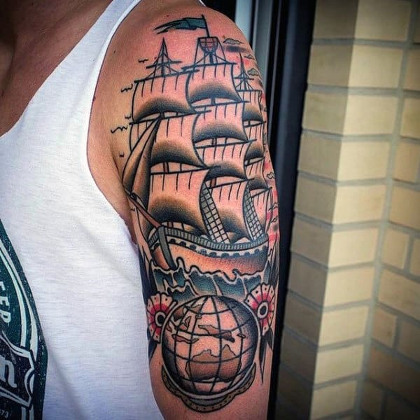 Old School Male Globe Arm Tattoo With Sailing Ship Design