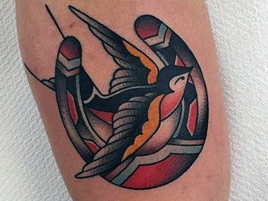 Swallow Tattoo Meanings – What Do Swallow Tattoos Symbolize?