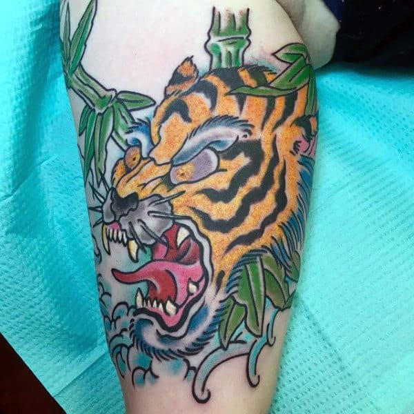 Old School Roaring Japanese Tiger With Bamboo And Ocean Waves Tattoo For Guys