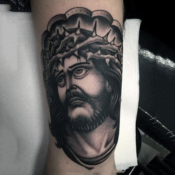 Old School Style Jesus Christ Tattoo On Mans Arm
