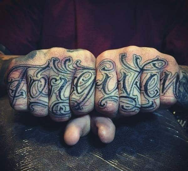 One Word Mens Knuckle Tattoo With Forgiven In Script Font