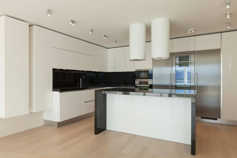 Open Layout Black And White Kitchen 10