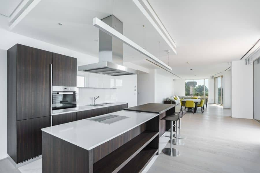 Open Layout Black And White Kitchen 5