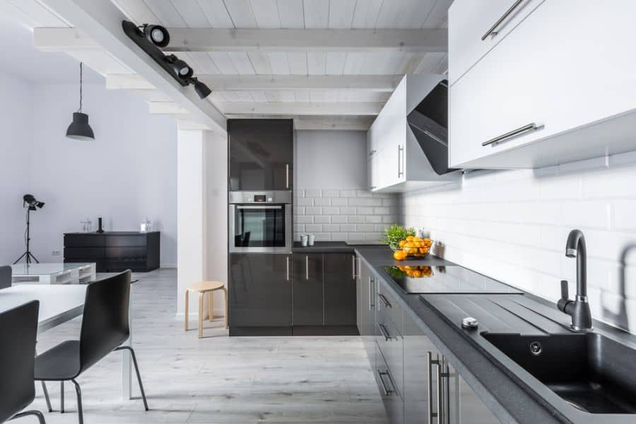 Open Layout Black And White Kitchen 8