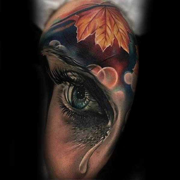 Orange Leaf With Tear Eye Guys Realistic Arm Tattoo