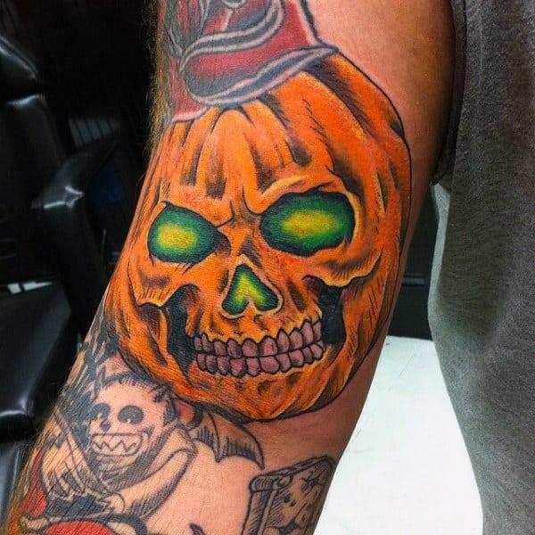 Orange Pumpkin With Glowing Green Eyes Mens Arm Tattoo