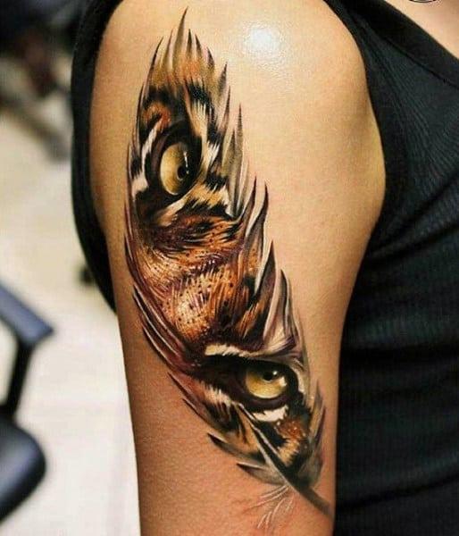 Orange Tiger Eye Feather Tattoo Design On Arms For Men