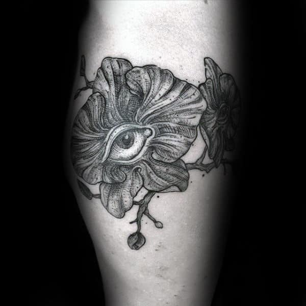 Orchid Flower With Eye Mens Tattoo Designs On Leg