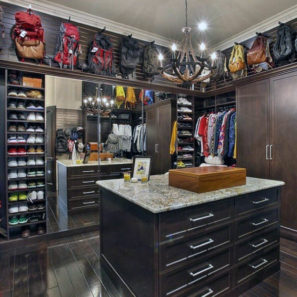 Organized Mens Closet With Island Cabinet In Middle Of Room
