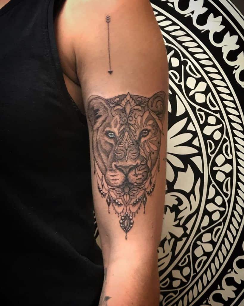 Ornamental Woord Cut Lioness Tattoo