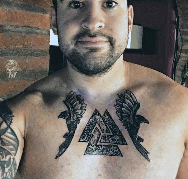 Ornate Male Valknut Upper Chest Tattoo With Bird Design