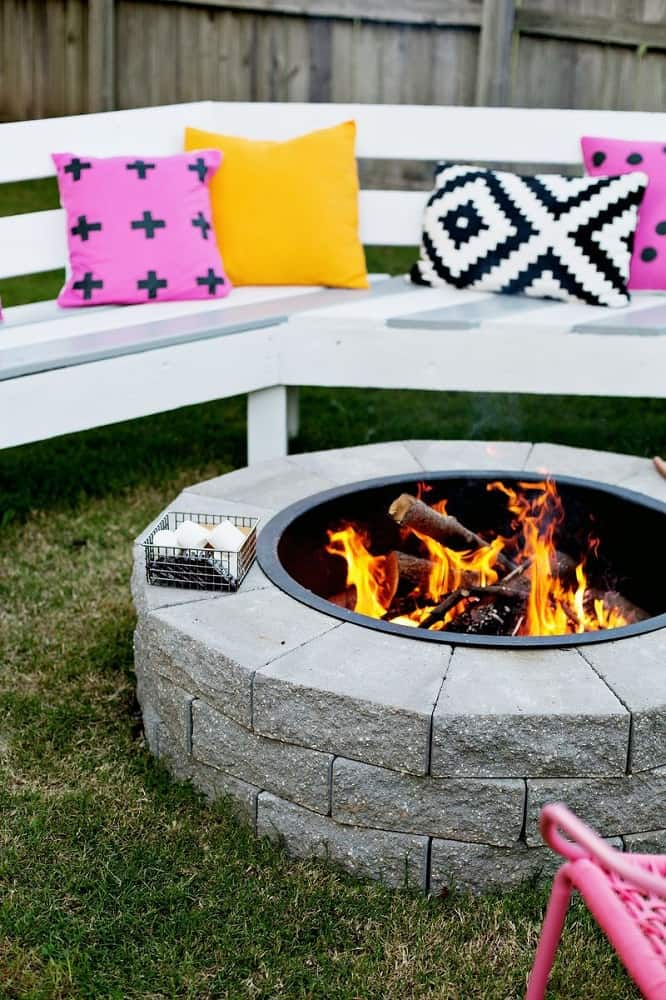 outdoor fire pit with white seating