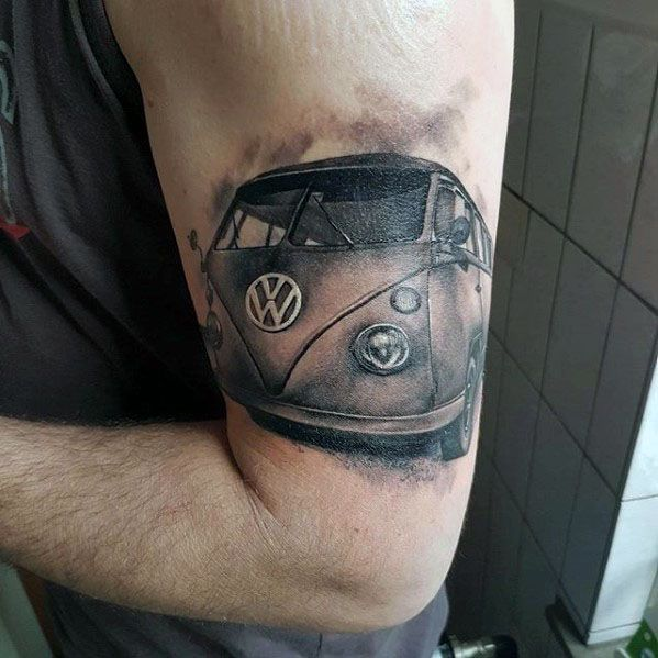Outer Arm Male Tattoo With Volkswagen Wv Design