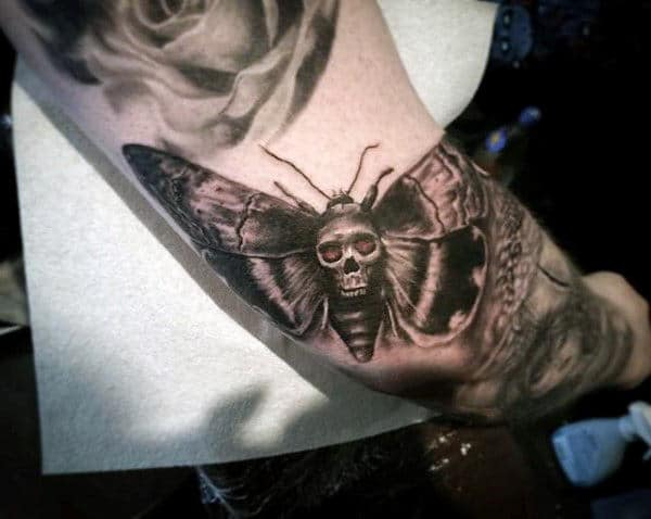 Outer Arm Masculine Moth Tattoo On Male