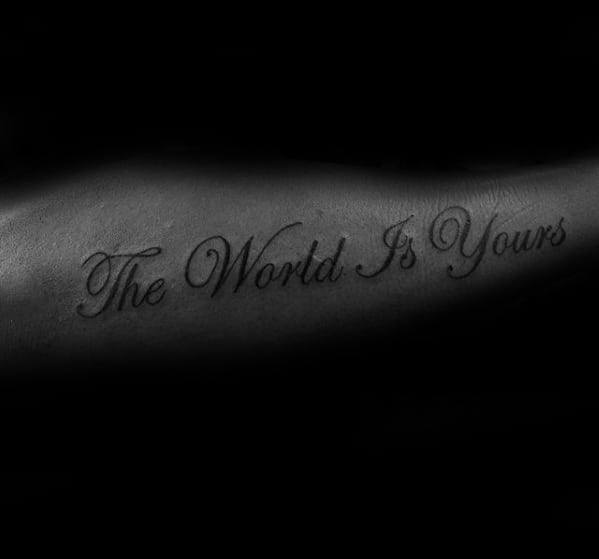 Outer Forearm Cursive Quote The World Is Yours Tattoo On Gentleman