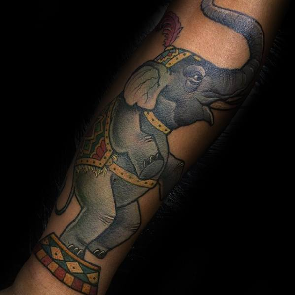 Outer Forearm Elephant Standing Up Male Circus Tattoo Design Inspiration