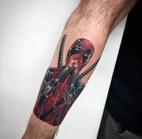 Outer Forearm Male Deadpool Flaming Guns Tattoo