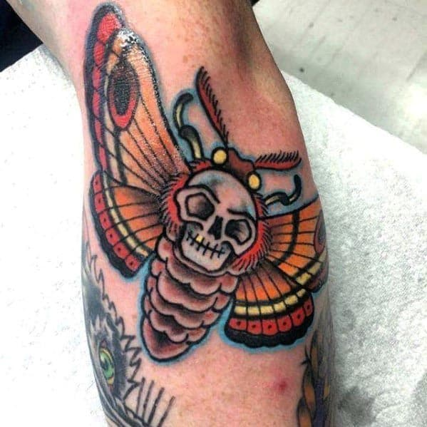 Outer Forearm Male Traditional Skull And Moth Tattoo Designs