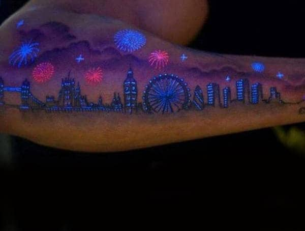 Outer Forearm Mens Glow In The Dark Tattoo Of Skyline With Fireworks Design