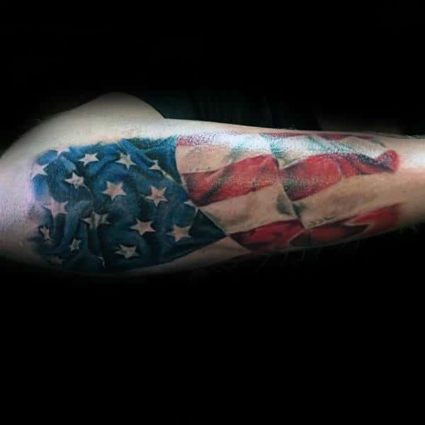 Outer Forearm Patriotic Waving United States Of America Flag Tattoo On Male