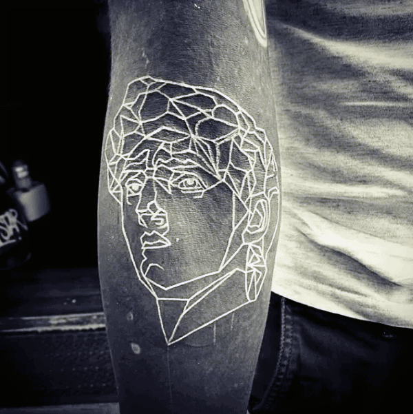Outline Potrait Of Face Mens Sleeve Tattoo With White Ink Over Black Ink On Inner Forearm
