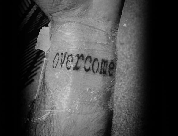 Overcome Single Word Tattoo Designs For Guys On Wrist