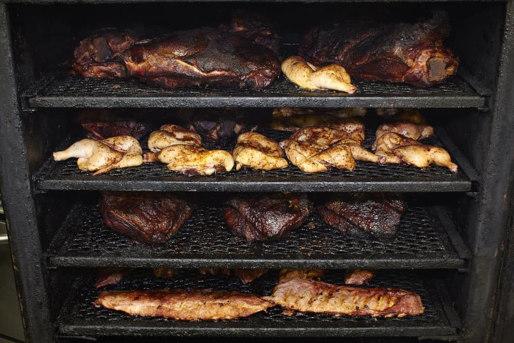 different types of meat inside packed meat smoker
