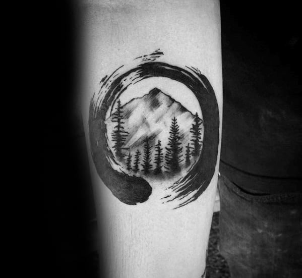 Paint Brush Stroke Circle With Trees And Mountains Guys Small Forearm Tattoo