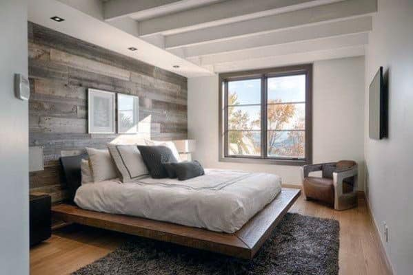 Painted White Drywall With Reclaimed Wood Accent Wall In Master Bedroom
