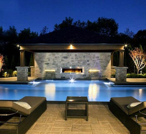 Patio Outdoor Rustic Stone Fireplace With Pool Lounge