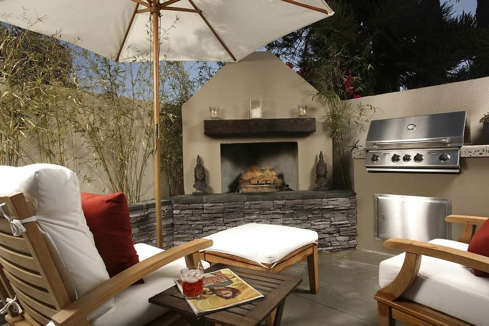 outdoor patio with fireplace and white seating