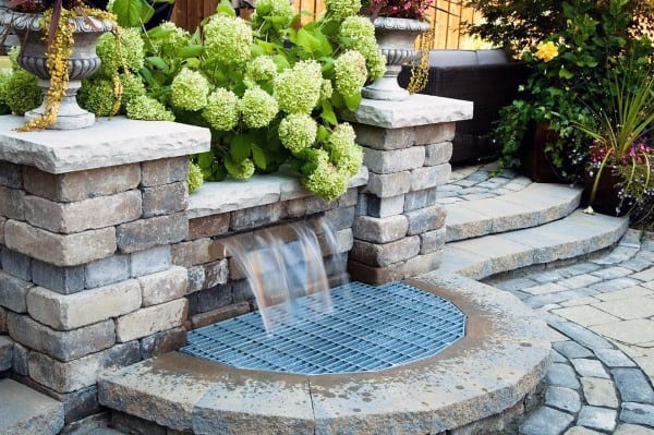 Paver Stone Backyard Waterfalls With Steel Grate