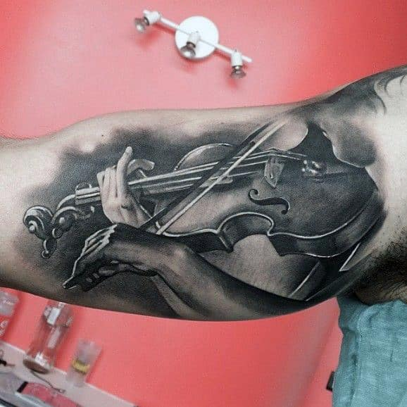 Pencil Art Man Playing Music Tattoos On Bicep For Men