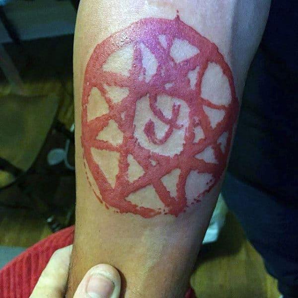 Pentagram Red Ink Inner Forearm Tattoos For Guys