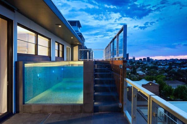 Penthouse Home Swimming Pool With Clear Glass Window Looking Into Blue Water